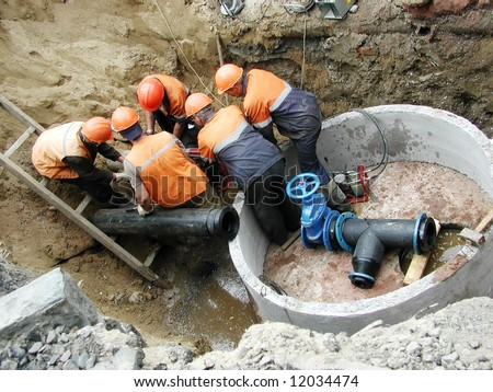 group of workers repaired water pipe
