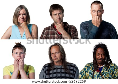 Group of worried people looking at the camera, isolated studio image - stock photo