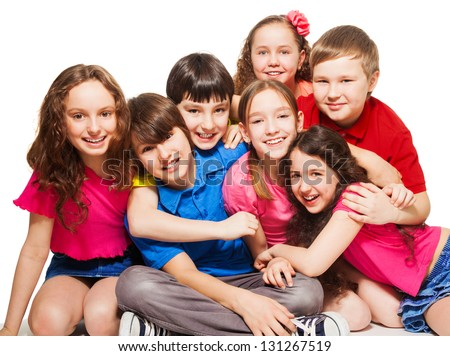 Group of 10 years old kids, boys and girls, hugging, smiling, laughing, on white - stock photo