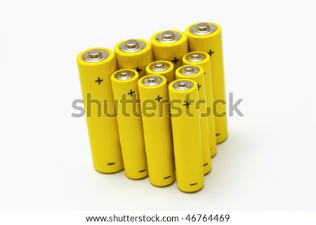 group of yellow anonymous alkaline batteries isolated on white background - stock photo
