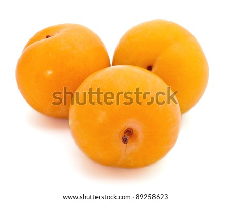 Group of yellow plums on white background