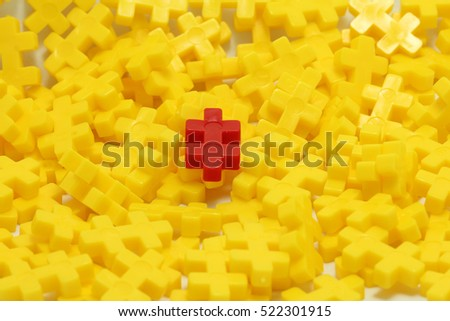 Group of yellow puzzle and one different r