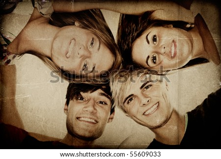 Group of young adults hugging - Textured - stock photo