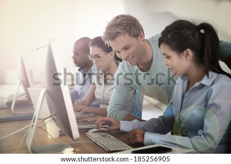 Group of young adults in business training - stock photo