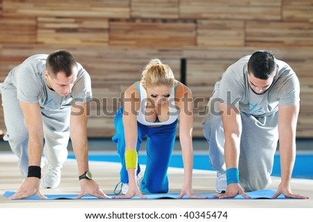 group of young adults in start position ready to run and race - stock photo