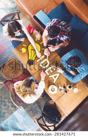 Group of young and creative people at the table, talking, planing  - stock photo
