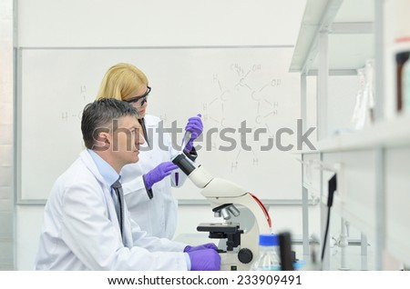 group of young and successful research scientist in the laboratory of the University - stock photo