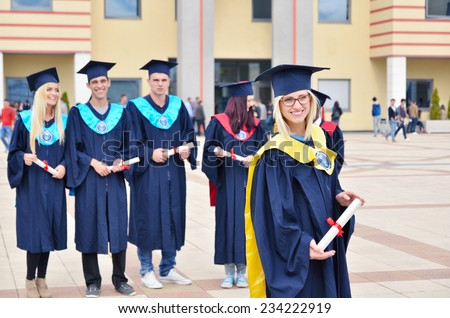 group of young and successful students, black, white, and girls the celebration certificate - stock photo