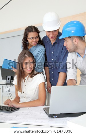 Group of young architects in business meeting - stock photo