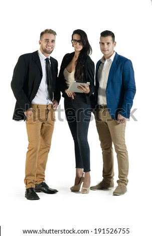 group of young attractive executives standing together with digital tablet - stock photo