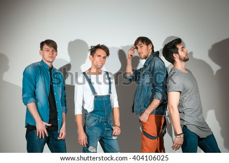 group of young attractive men posing in the studio - stock photo