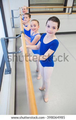 group of young ballet dancers in studio - stock photo