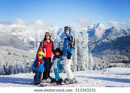 Group of young beautiful people, adults and kids, skiing in Alps, winter time - stock photo