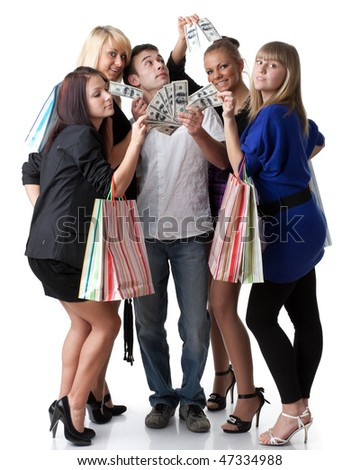 Group of young beautiful women with shopping bags take money from the man on a white background. - stock photo