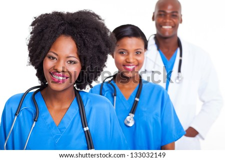 group of young black healthcare workers on white background - stock photo
