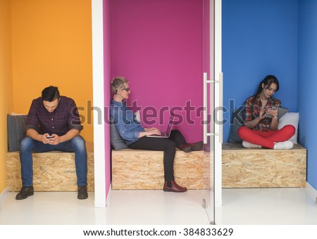 group of young business people having fun, relaxing and working in creative room space at modern startup office - stock photo