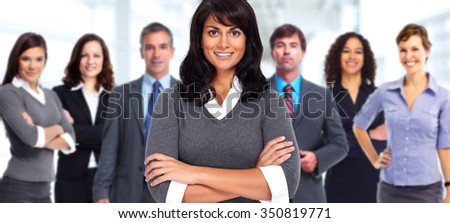 Group of young business people over modern office background.