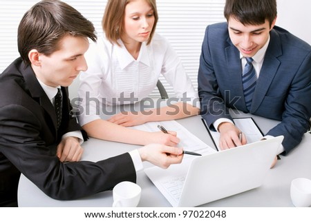 Group of young business people working together at a meeting - stock photo