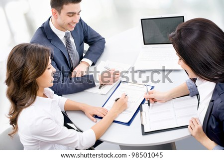 Group of young business people working together at office - stock photo