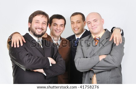 Group of young businessmen together on light background - stock photo