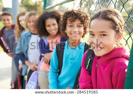 Group Of Young Children Hanging Out In Playground - stock photo