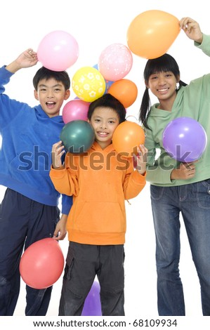 Group Of Young Children In Studio With Balloons