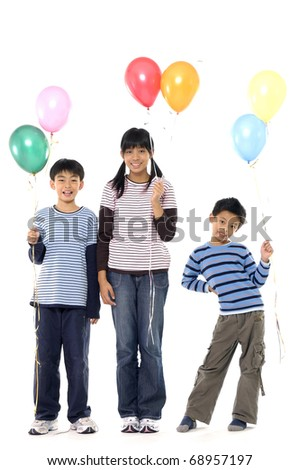 Group Of Young Children In Studio With Balloons - stock photo