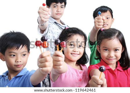 Group of young children showing some lollipops. - stock photo