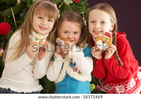Group Of Young Children With Presents In Front Of Christmas Tree - stock photo