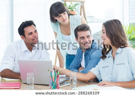 Group of young colleagues having a meeting at office
