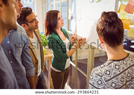 Group of young colleagues in discussion at office - stock photo