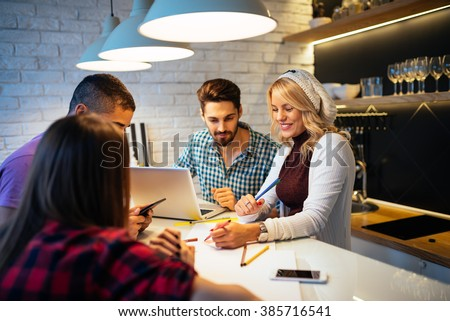 Group of young colleagues working on their small business. - stock photo