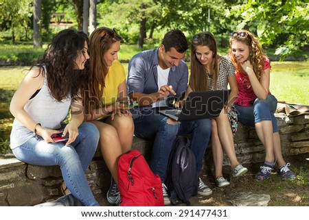 Group of young college students at park  - stock photo