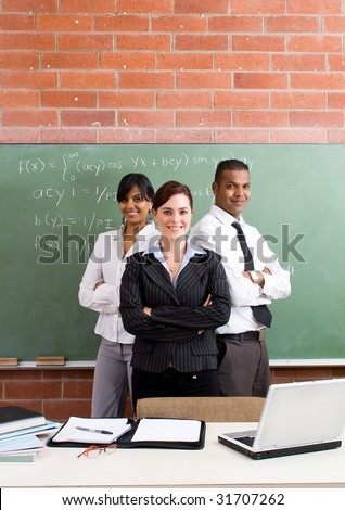 group of young confident school teachers in classroom