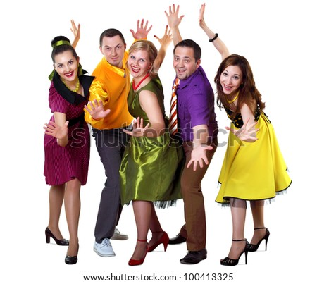 group of young dancing people in bright colour wear - stock photo