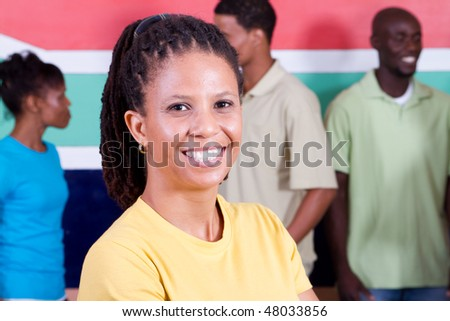 group of young diversity people in front of South African flag, 2010 Fifa world cup concept - stock photo