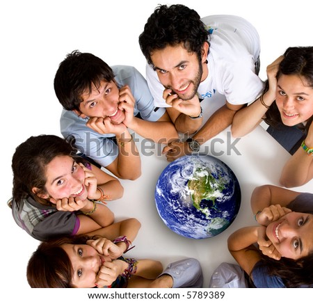 group of young ecologists smiling at the camera with a globe in the middle of them - stock photo