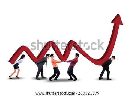 Group of young entrepreneurs lifting up a business graph with upward arrow in the studio - stock photo