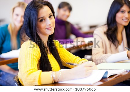 group of young female college students in classroom - stock photo