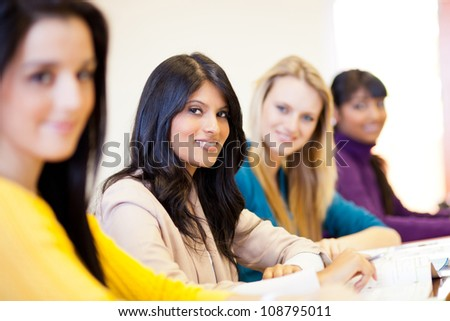 group of young female university students in classroom - stock photo