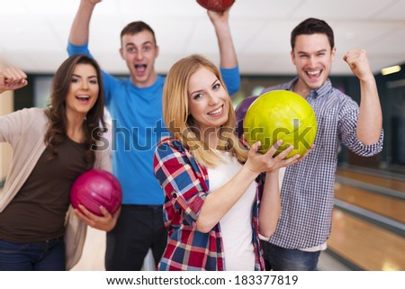 Group of young friend at the bowling alley