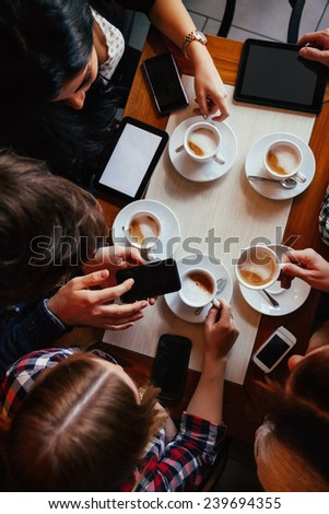 Group Of Young Friends Drinking Coffee In Cafe. View From above - stock photo