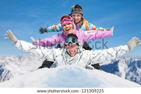 Group of young friends enjoying  in winter resort - stock photo