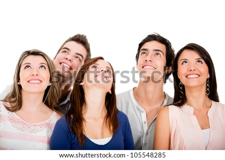 Group of young friends looking up - isolated over white - stock photo