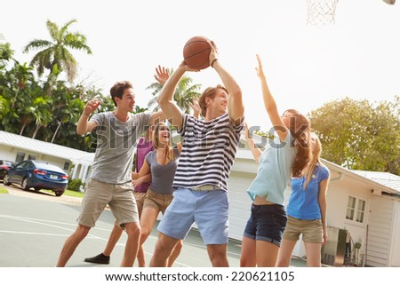 Group Of Young Friends Playing Basketball Match - stock photo