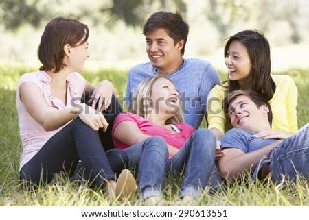 Group Of Young Friends Relaxing In Countryside
