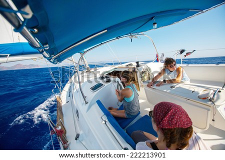 Group of young friends sailing in a blue sea - stock photo