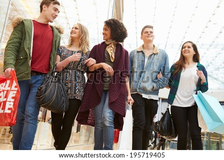 Group Of Young Friends Shopping In Mall Together - stock photo
