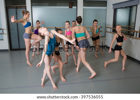 Group of young girls having fun in dance studio - stock photo