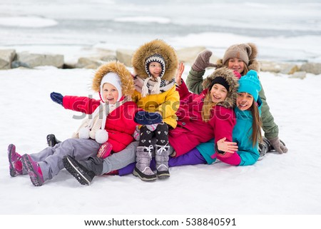 Group of young girls who walks outdoors on the frozen lake